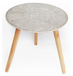 A beautifully decorative wooden side table with an embossed pattern. A chic and on trend interior accessory for the home
