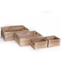 A set of 4 assorted sized natural wooden crates with added chunky rope handles