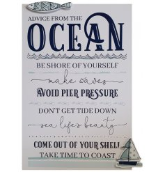 A white wooden plaque featuring a coastal scripted text