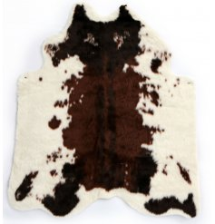 A faux cowhide rug, perfect for adding a statement feature to any home interior