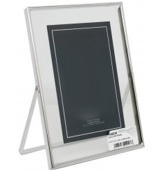 A beautifully modern themed picture frame with a glass front and silvered metal surround