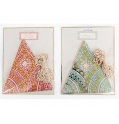 An assortment of pink an blue toned string bunting featuring charming gold patterns and decals