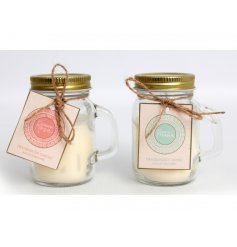 An assortment of mini glass mason jars filled with sweetly scented candles