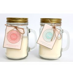 An assortment of glass mason jars filled with sweetly scented candles and packaged with charming pink and blue tags