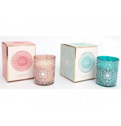 An assortment of pattern printed glass candles filled with sweetly scented candles