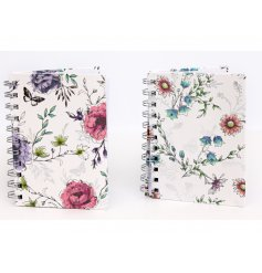 An assortment of hardback notebooks featuring pretty colours and floral patterns
