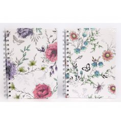 A mix of 2 pretty floral design notebooks with whimsical flowers and butterflies.
