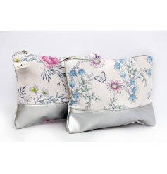 A stylish mix of sweetly printed fabric Makeup bags complete with a block silver base