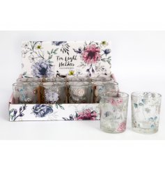 A mix of floral inspired glass tlight holders, each decorated with its own colour and print