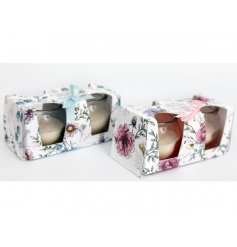 An assortment of sweetly scented candles, beautifully packaged within Spring inspired printed packaging