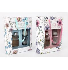 Bring the beautiful fragrance of the garden indoors with this pretty Secret Garden gift set including candles and reed