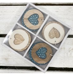 8 hanging wooden decorations with blue and white polka dot patterns and heart cut features