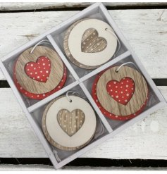 8 hanging wooden decorations with red and white polka dot patterns and heart cut features