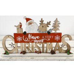 A natural wooden plaque featuring a cut Christmas Text and added festive friend decal