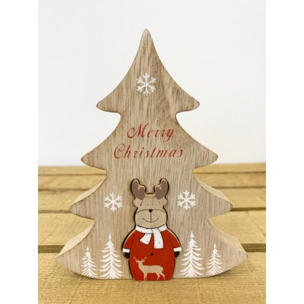 A natural toned wooden tree block with scripted text decals and an added reindeer centre piece