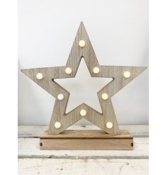 A natural wooden star with added LED fitted lights