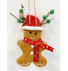 An adorable fuzzy felt gingerbread man complete with a festive hat and scarf!