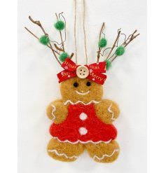 An adorable fuzzy felt gingerbread decoration complete with a festive hat and scarf!