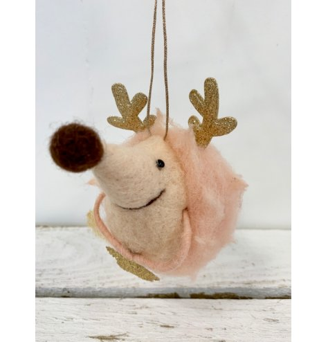 A delicate pink hedgehog with large feature nose and sparkly gold antlers and star detail.
