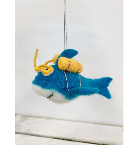 A turquoise green snorkelling shark decoration.