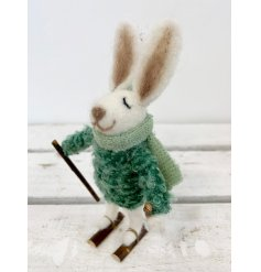 A cute little woollen bunny with an adorable green knitted jumper decal and skis