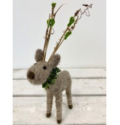 An adorably fuzzy felt reindeer with added antlers and a wreath collar,