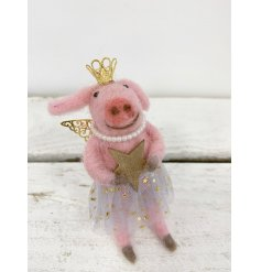 A delightful little pink fuzzy piggy hanging decoration, perfectly dressed up as a Princess Ballerina