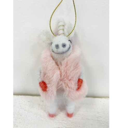 This wool unicorn is a little diva in her faux fur pink jacket and golden string to hang.