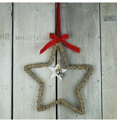 A simple yet chic hanging wicker star featuring a red ribbon hanger and added silver heart decals