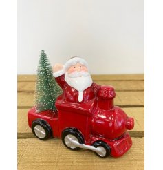 A fun themed ceramic train with an added Santa and LED tree decal