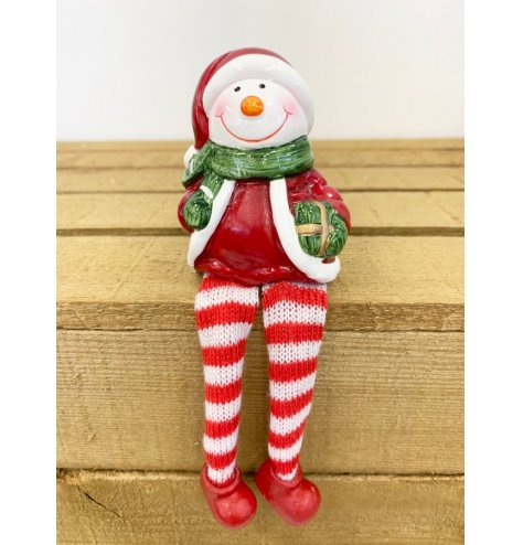 An adorable friendly sitting Snowman with long dangly legs. Other characters also available to complete the set.