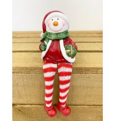 A sweet little shelf sitting ceramic Snowman with long dangly legs