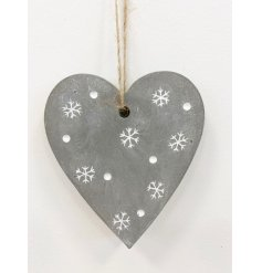 A cement heart hanging decoration with added snowflake decals