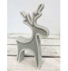 A sleek and stylish standing ceramic reindeer complimented with a washed grey tone and embossed line decal