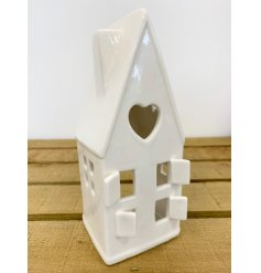 A ceramic based house decoration with an added space to put a t-light