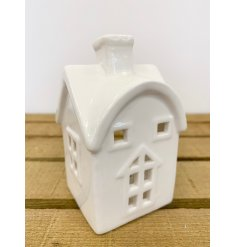 A chic little ceramic house with added space for a tlight holder