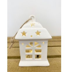 A sweet and chic little ceramic hanging house decoration, beautifully illuminated by a warm glowing LED Centre