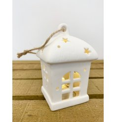 A charming little ceramic hanging house with a fitted warm glowing LED centre