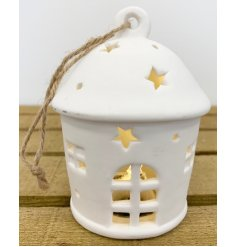 this charming little white ceramic house hanging decoration will be sure to hang perfectly amongst any additional decor
