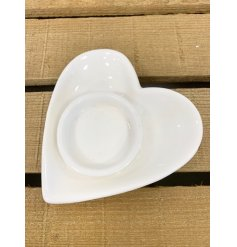A sweet ceramic heart plate with an added tlight holding featuring