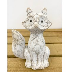 A cute little white washed fox decoration with an added wood carving inspired decal