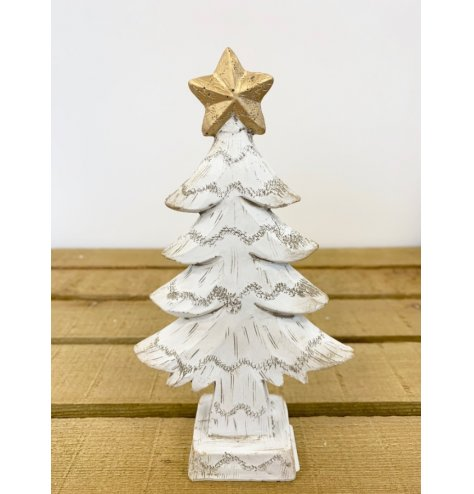 A resin based Christmas tree with a wooden effect. In a distressed white finished with a golden star on top.