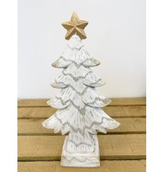 A charming white washed tree decoration with an added wood carving inspired decal and gold star top