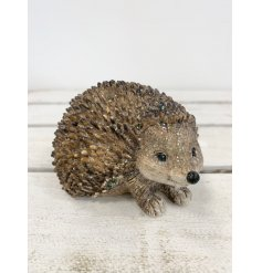 An adorable little resin based hedgehog decoration coated with a subtle sprinkle of glitter