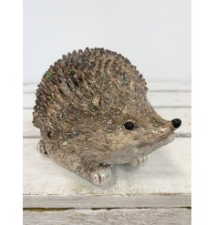 this adorable sitting resin hedgehog figure will be sure to tie in perfectly with any Winter Woodland inspired home