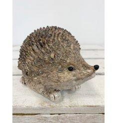 An adorable little resin based hedgehog decoration coated with a subtle sprinkle of glitter