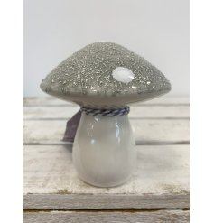 Add this small grey toned ceramic mushroom to any Winter Woodland inspired home displays for an added charm