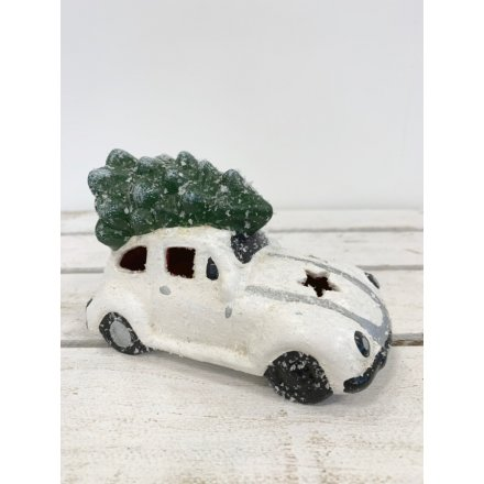 A white toned resin Bug Car with an added flurry of snow and fitted LED effect