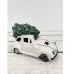 Bring a fun and traditional hint to your home decor at Christmas time with this quirky white toned Beetle Car Decoration