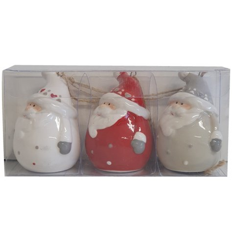 A set of adorable hanging Santa figurines in red, white and grey with delicate painted detail.